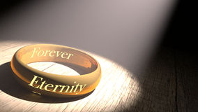 Golden ring. With eternity engraved Royalty Free Stock Photos
