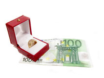 Golden ring and euros Royalty Free Stock Photography