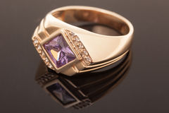 Golden ring with gem. Fashion Jewelry background Royalty Free Stock Images