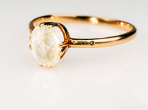 Golden ring with gem over white Royalty Free Stock Image