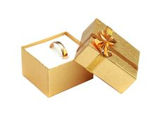 Golden ring in gift box. Isolated on white Stock Photo