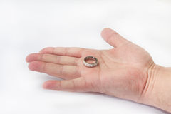 Golden ring on the hand isolated on the white background Royalty Free Stock Photography