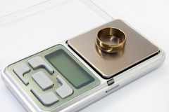 Golden ring on the jewelry digital scale.  Stock Images