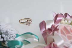 The golden ring lies on the background of wedding boutiques. On a white background. Stock Photography