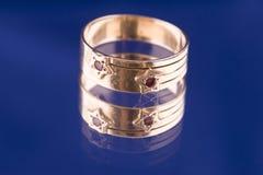 Golden ring macro on blue Stock Image