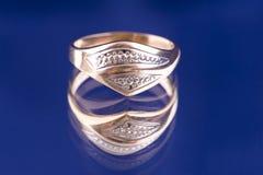 Golden ring macro on blue Royalty Free Stock Photos