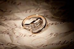 Golden Ring And Old Manuscript Stock Photos
