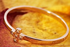 Golden ring with an ornament in the form of a cross Stock Photography
