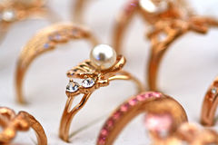 Golden ring with pearl an diamonds Royalty Free Stock Images