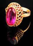 Golden ring with pink gem Royalty Free Stock Photography