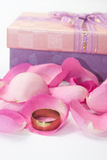 Golden ring on a pink rose petals Royalty Free Stock Images