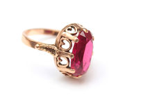 Golden ring with pink sapphire Royalty Free Stock Image