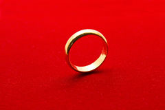 Golden Ring on Red Background Stock Photography
