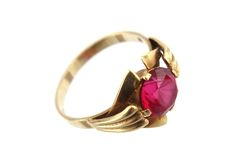 Golden ring with red gem Stock Photo