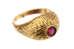 Golden ring with red gem Royalty Free Stock Image