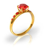 Golden ring with red jewels Stock Image