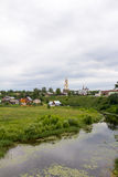 The Golden ring of Russia. Suzdal. View of the river Kamenka and the Church. Stock Photography