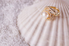 The golden ring and sea shell Royalty Free Stock Photography