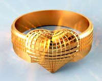Golden ring in the shape of  heart Stock Photos