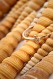 Golden ring with shells Stock Image