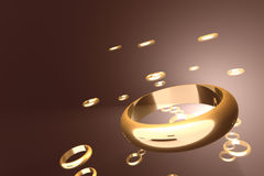 Golden rings. Floating in hazy space. The picture has a certain depth of field, sharpest point is at the top-front of the biggest ring Royalty Free Stock Image