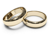 Golden Rings. Golden engagement rings, lying one on the other Stock Images