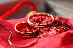 Golden rings on background Stock Photo