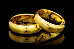 Golden  rings on a black Royalty Free Stock Photo