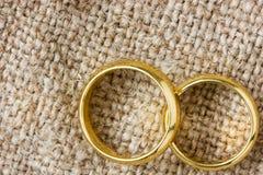 Golden rings on the burlap Stock Photo