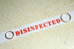 Golden rings on a disinfected note Stock Photos