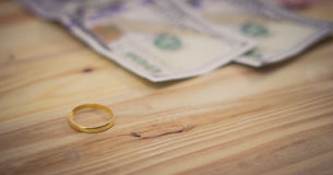 Golden  rings and dollar banknotes Stock Photos