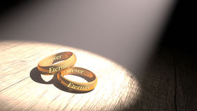 Golden rings. With eternity engraved Stock Photo
