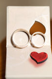 Golden Rings on Gift Box Stock Photography