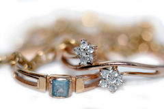 Golden rings and gold Stock Photos