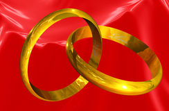 Golden Rings of Love. Concatenated rings with love text inside on red silk background Stock Images