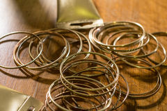 Golden rings with parts of tubes Royalty Free Stock Images