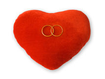 Golden rings on red heart Royalty Free Stock Images