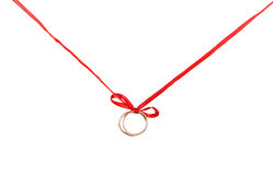 Golden rings on a red ribbon Stock Image