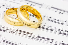 Golden rings on the  sheet music Royalty Free Stock Images
