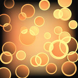 Golden rings, vector. Abstract background with glowing circles Stock Images