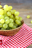 Golden ripe grapes in a basket Royalty Free Stock Photos