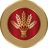 Golden ripe wheat sheaf in circle on red background. Vector decorative element, brand icon or logo template Royalty Free Stock Images
