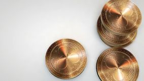 Golden ripple coins falling on white background. Animation stock video footage