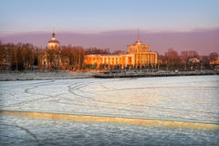 Golden River Station. Riverport in the last rays of the winter sun on the shore of a frozen river Stock Photos