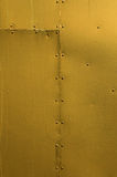 Golden Riveted Sheet Metal Background Stock Image