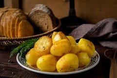 Golden roasted potatoes Stock Photos