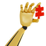 Golden robotic hand with red puzzle Royalty Free Stock Image