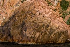 Golden rock formations in the marine national park. On the island of Corsica Stock Photo