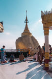 The Golden Rock, Myanmar-February 21,2014 :Kyaiktiyo Pagoda. The Golden Rock, Myanmar - February 21, 2014 : Buddhist are sittTg and waiting for worship in front Stock Images