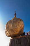 The Golden Rock ,Myanmar-February 21,2014 : Kyaiktiyo Pagoda. The Golden Rock, Myanmar - February 21, 2014 : Buddhist are sittTg and waiting for worship in front Stock Photography